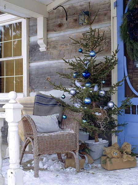 Christmas tree on snowy veranda